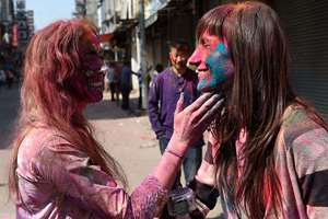 Foreigners celebrate Holi at Paharganj, in New Delhi.