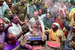Madhya Pradesh Chief Minister Shivraj Singh Chouhan with his wife Sadhna Singh sings a song during Holi celebrations at his residence, in Bhopal.