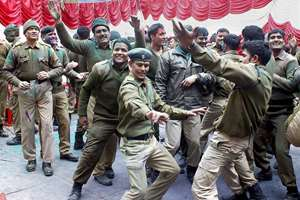 CRPF officials and personnel celebrating Holi in Srinagar.