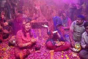 Devotees celebrates 'Holi' in the Mahakal Temple, in Ujjain, Madhya Pradesh.
