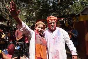 Actress Shabana Azmi and her husband lyricist Javed Akhtar celebrate Holi at their residence, in Mumbai.