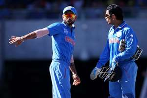 Captain MS Dhoni, right, talks with teammate Virat Kohli during their Cricket World Cup semifinal against Australia in Sydney, Australia.