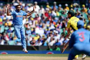 Mohammed Shami, left, reacts after bowling to Australia's Aaron Finch during their Cricket World Cup semifinal in Sydney, Australia.