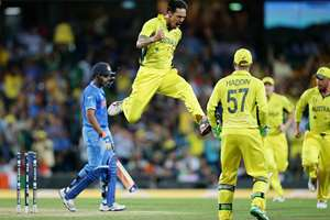Australia's Mitchell Johnson leaps in the air as he celebrates after taking the wicket of Rohit Sharma during the Cricket World Cup semifinal in Sydney, Australia.