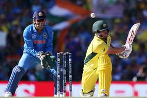 Australia's Aaron Finch plays and misses at the ball as MS Dhoni watches during the Cricket World Cup semifinal in Sydney, Australia.
