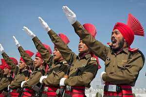 Newly graduated soldiers of the Army's Jammu and Kashmir Light Infantry Regiment (JKLIR) take oath during their commencement parade at a military base on the outskirts of Srinagar. 183 recruits from Jammu and Kashmir were formally inducted into JKLIR after completing their training.