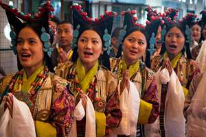Tibetan artists in traditional costumes sing a welcome song for their spiritual leader the Dalai Lama on his arrival at the Tibetan Institute of Performing Arts in Dharmsala.
