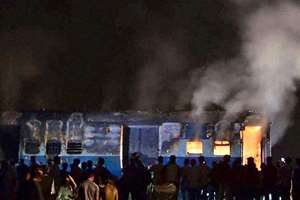 The sleeper class coach of Saket Express after it caught fire near Naini railway station in Allahabad.