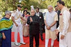President Pranab Mukherjee arrives to confer the Bharat Ratna on former Prime Minister Atal Bihari Vajpayee at his residence in New Delhi. Prime Minister Narendra Modi and Vajpayee's daughter Namita Kaul are also seen.