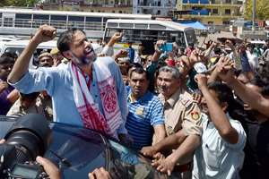 Yogendra Yadav raises slogans with supporters after he was expelled from the AAP national executive at Kapashera, in New Delhi.