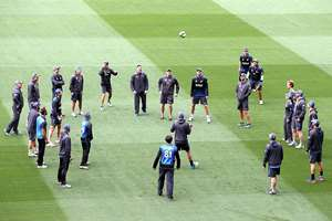 New Zealand players and assistants play a ball game to warm up during training for the Cricket World Cup final at the Melbourne Cricket Ground in Melbourne, Australia. New Zealand will play Australia in the final on Sunday 29 March 2015.