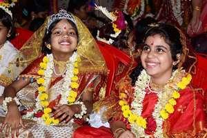 Girls being worshipped during Kumari Puja at Dakhineswar Ramakrishna Aadahyapitih on the occasion of Ram Navami festival in Kolkata.
