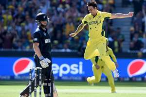 Australia's Mitchell Johnson celebrates after taking the wicket of New Zealand's Kane Williamson during the Cricket World Cup final in Melbourne, Australia.