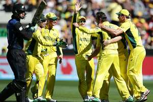 Australian players celebrate after taking the wicket of New Zealand's Martin Guptill, left, during the Cricket World Cup final in Melbourne, Australia.