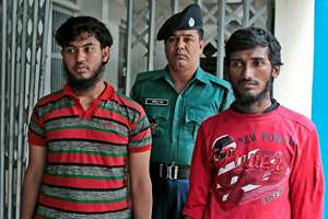 A Bangladeshi policeman escorts Jikrullah, left and Ariful Islam, two among  three suspected of the killing of a blogger as they are presented before the media in Dhaka, Bangladesh. Blogger Washiqur Rahman Babu, 26, was hacked to death by three men in Bangladesh's capital. The killing took place a month after a prominent Bangladeshi-American blogger known for speaking out against religious extremism was hacked to death in Dhaka.