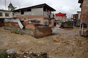 Houses are partially submerged in flood waters in Srinagar.