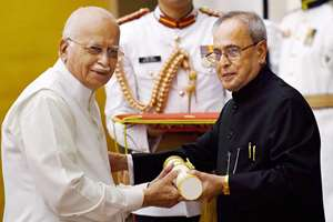 President Pranab Mukherjee presents Padma Vibhushan to Lal Krishna Advani during the function of Padma Awards 2015 at Rashtrapati Bhawan, in New Delhi.