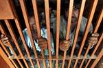 Detained Indian fishermen look out from a police lockup facility at a police station in Karachi, Pakistan.  A Pakistani police officer said the country's Maritime Security Agency has arrested over 45 Indian fishermen for violating its waters in the Arabian Sea.