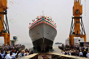Indian Navy's newly built warship INS Visakhapatnam sails into the Arabian Sea during its launch at Mazagon Dock in Mumbai.