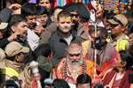 Kedarnath temple head priest Rawal Jagadguru Bhimashankar Linga Shivacharya and Congress Vice President Rahul Gandhi queue outside the Kedarnath temple to offer their prayers.