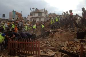Rescuers clear the debris at Durbar Sqaure after an earthquake in Kathmandu, Nepal.