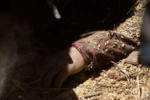 The hand of a dead woman is seen in a collapsed building following the earthquake, in Bhaktapur, on the outskirts of Kathmandu, Nepal.