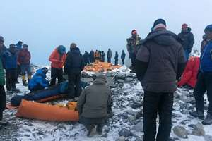 People critically injured in an avalanche are wrapped to be evacuated out of Everest Base Camp, Nepal.