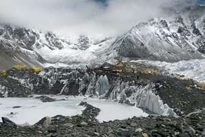 A rescue chopper prepares to land, carrying people from higher camps to Everest Base Camp, Nepal.