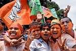 BJP activists celebrate after their candidate won in Kolkata Municipal Corporation Election, in Kolkata.