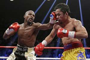 Floyd Mayweather Jr., left, hits Manny Pacquiao, from the Philippines, during their welterweight title fight in Las Vegas.