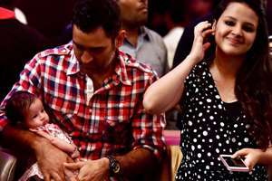 Mahendra Singh Dhoni with his daughter Ziva and wife Sakshi Dhoni at an event in Chennai.