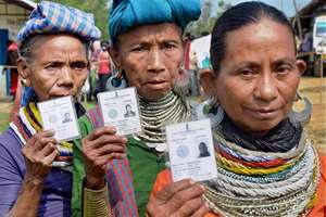 Reang tribal women walk out of a polling booth after casting their vote for Tripura Tribal Areas Autonomous District Council (TTAADC)  at Ambasha District, in Agartala.