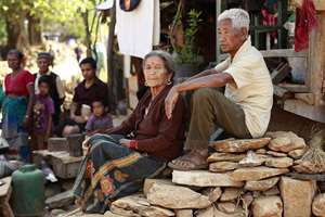 In this photo, Fattha Bahadur Rana, 90, right, sits with his wife Thama Kumari Rana, 82, sits in the rubble of his collapsed home in the destroyed village of Pokharidanda, near the epicenter of the April 25 massive earthquake, in the Gorkha District of Nepal.