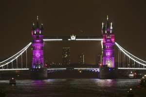 Tower Bridge is lit up to celebrate the Duke and Duchess of Cambridge's newborn baby, in London, UK.