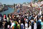 Devotees take a dip in the Ganga river at Har Ki Pauri on the occasion of Buddha Purnima in Haridwar.