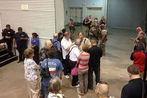People are sequestered by members of the Garland Police Department inside the Curtis Culwell Center in Garland, Texas, USA. A contest for cartoons depictions of the Prophet Muhammad in the Dallas suburb is on lockdown Sunday after authorities reported a shooting outside the building.