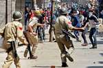 Policemen fire teargas shells towards stone pelters during a clash after a protest by Congress workers against the BJP-PDP government's alleged anti-people policies in Srinagar.