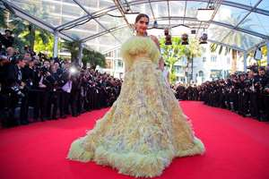 Actress Sonam Kapoor poses for photographers as she arrives for the screening of the film Inside Out at the 68th international film festival, Cannes, southern France.