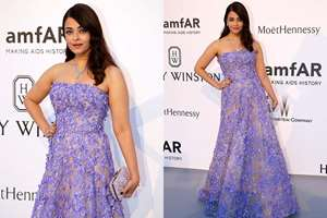Aishwarya Rai Bachchan poses for photographers upon arrival for the amfAR Cinema Against AIDS benefit at the Hotel du Cap-Eden-Roc, during the 68th Cannes international film festival, Cap d'Antibes, southern France.