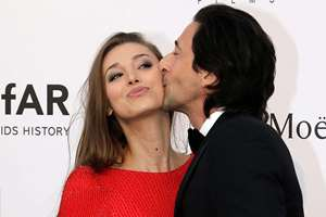 Actor Adrien Brody, right, kisses Lara Lieto as they pose for photographers upon arrival for the amfAR Cinema Against AIDS benefit at the Hotel du Cap-Eden-Roc, during the 68th Cannes international film festival, Cap d'Antibes, southern France.