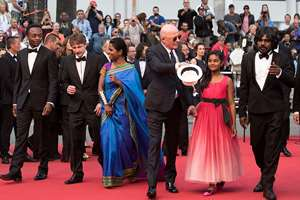 From left, Marc Zinga, Vincent Rottiers, Kalieaswari Srinivasan, director Jacques Audiard, Claudine Vinasithamby and Jesuthasan Antonythasan arrive for the screening of the film Dheepan at the 68th international film festival, Cannes, southern France.