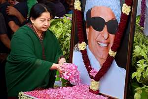 AIADMK General Secretary J. Jayalalitha paying floral tribute at former chief minister and party founder MGR's statue in Chennai.  Jayalalithaa, expected to take oath as Chief Minister submitted to Governor Rosaiah a list of names who will be made ministers, in her government.