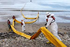 Workers prepare an oil containment boom at Refugio State Beach, north of Goleta, California. More than 7,700 gallons of oil has been raked, skimmed and vacuumed from a spill that stretched across about 9 miles of California coast, just a fraction of the sticky, stinking goo that escaped from a broken pipeline.