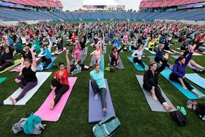 Participants take part in a yoga class at LP Field, home of the Tennessee Titans NFL football team, in Nashville, Tenn. About 1,000 people were registered to take part in the class, which was also a benefit for Soles4Souls, a global not-for-profit organization that distributes shoes and clothing.