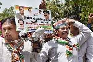 Delhi Pradesh Congress Committee (DPCC) activists protest against Prime Minister Narendra Modi and Delhi Chief Minister Arvind Kejriwal at Jantar Mantar, in New Delhi.