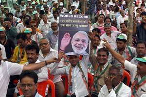 Congress party workers in a rally protesting against the BJP government, in Mumbai.