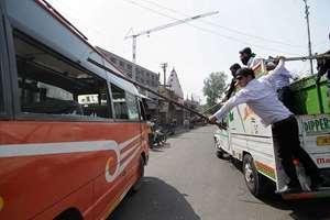 Members of Bar Association trying to stop a passenger bus during a bandh call against the government decision to hand over AIIMS to Kashmir which was originally offered to Jammu, in Jammu.