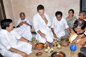 Congress Vice- President Rahul Gandhi having a meal at the house of a fisherman during a visit to the Blangad fishing colony at Chavakkad in Thrissur. Kerala CM Oommen Chandy is also seen.