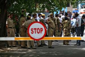 Policemen stand guard at the entrance to the cargo terminal of Indira Gandhi International (IGI) airport in New Delhi. A radioactive leak from a medical consignment imported for treating ailments was detected in the cargo area of the IGI airport in the capital. Home Minister Rajnath Singh later clarified that the small leak was contained and there was no threat to passengers. Two baggage handlers were reportedly taken for medical tests protectively.