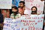 NSUI students protesting near the National Media Centre where Union HRD Minister Smriti Irani was attending a programme, in New Delhi.